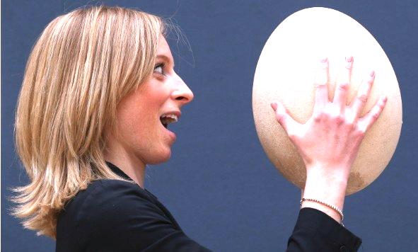 woman holding egg